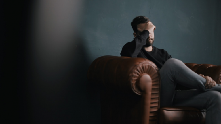 Man on couch disappointed Stop Erectile dysfunction in its tracks
